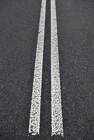 solid line: Asphalt road with white double solid line  Transportation background texture  Stock Photo