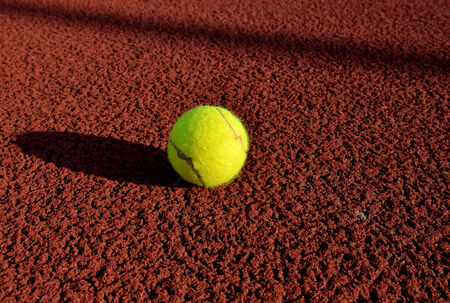 Tennis ball in a court. Useful for tennis background designs. photo