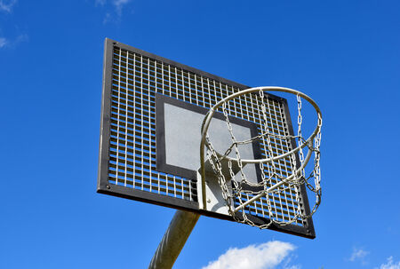 Basketball hoop, streetball rim against blue sky. photo