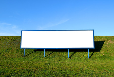 Outdoor white space for advertisement. Big blank billboard with blue sky. photo