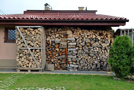 Firewood stacked stove or fireplace. Wood pile. photo