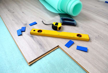 wooden metre: Floor panels, parquet, laminate, wood flooring and tools. Stock Photo