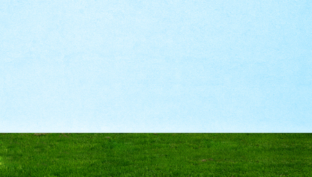 white blue wall and green grass texture background photo