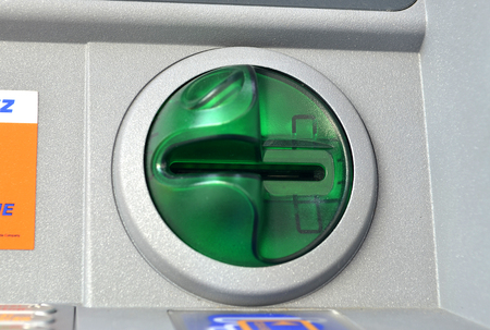 in insert: ATM insert card machine detail. Cash point close up Stock Photo