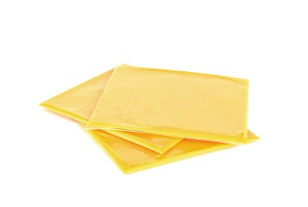 Slices of processed American cheese on white background Standard-Bild
