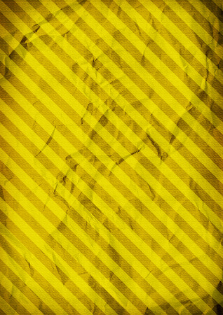 folded paper: Striped folded paper yellow background