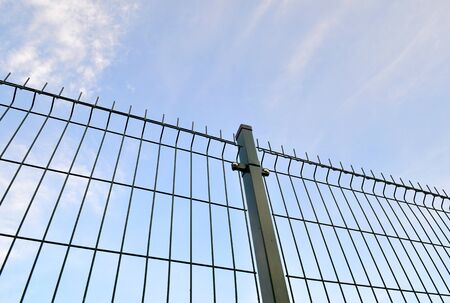 Fence steel welded mesh panels with a Blue Sky Background Stock Photo
