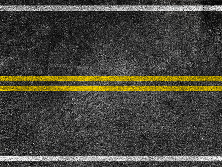 Asphalt road with double yellow lines Stockfoto