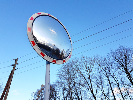 Road convex mirror traffic sign.
