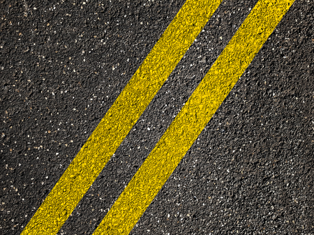 Asphalt road with double yellow lines Banque d'images