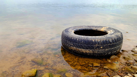 Environment pollution tire in lake.