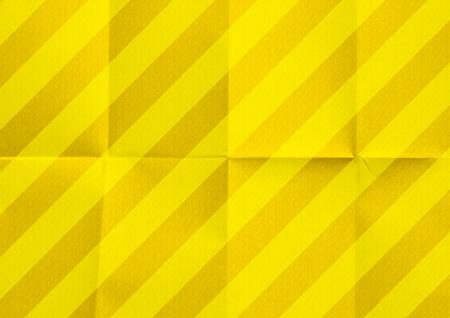 Fondo de textura de papel rayado amarillo