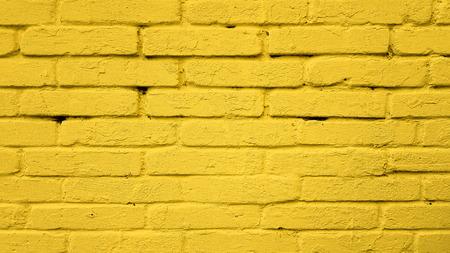 Yellow color brick wall texture background Banco de Imagens