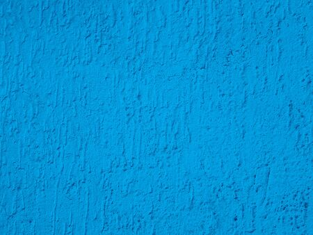 Detail of blue color plaster concrete empty wall background texture