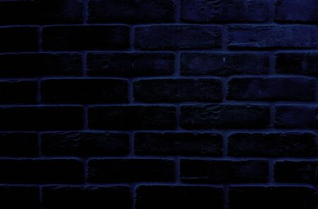 Dark spotlight brick wall  texture background.