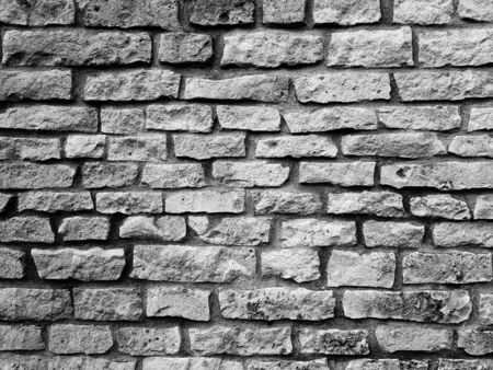Black grey brick old stone wall texture background