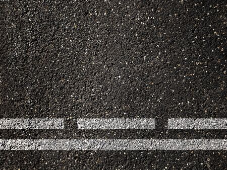 Dotted and solid double white lines on asphalt road