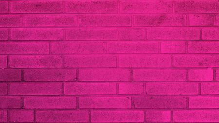 Old brick wall texture of pink stone blocks closeup for background Banco de Imagens