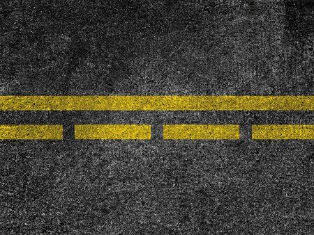 Asphalt road with dividing yellow lines Banco de Imagens
