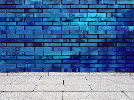 Old blue brick wall background with floor