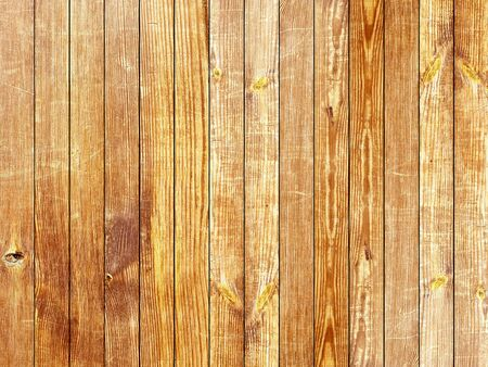 Brown mordant wooden vertical planks texture board background