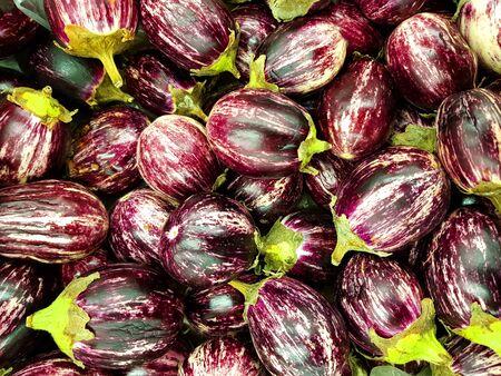 Asian eggplants. Chinese aubergine. Food background.