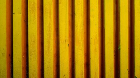 Corrugated steel sheet painted with yellow paint