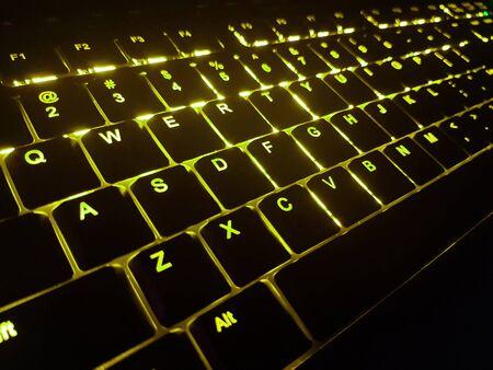 Yellow backlit low profile keyboard.