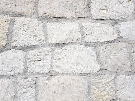 Old bright white pattern stone wall texture
