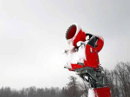 Snow cannon in winter scenery Banco de Imagens - 129449742