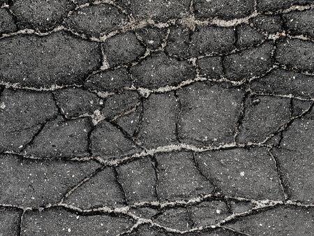 Black cracked asphalt texture.