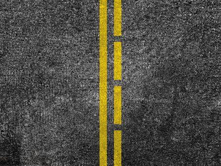 Asphalt road with dividing yellow lines Banque d'images