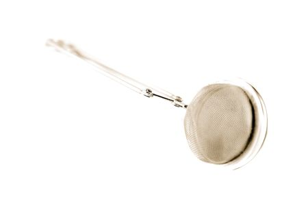 Toned photograph of stainless steel tea ball on white background all shot very high key. Stock Photo - 257487