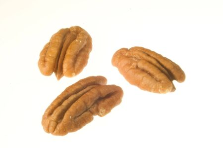 ingrediant: Photo of a three pecans isolated on white Stock Photo