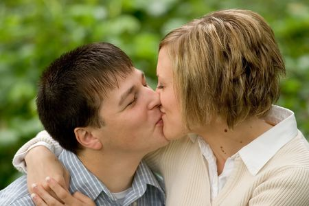 smooch: Photo of Tonya and Bryan during their engagement shoot.