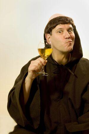 cassock: Photo of a monk enjoying his wine