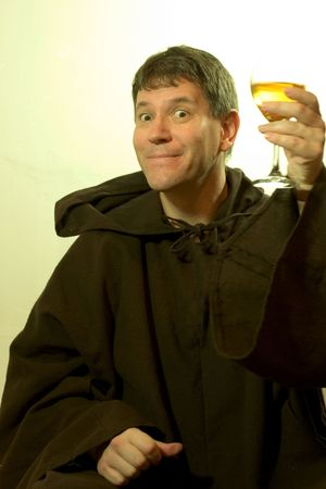 cassock: Photo of a monk looking enjoying a good glass of wine.