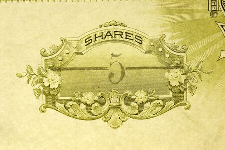Macro shot of antique stock certificate for five shares
