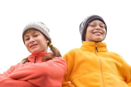 Foto van Kids in Ski Hoeden en Fuzzy Truien geïsoleerd op witte achtergrond Stockfoto