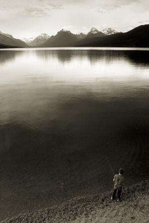 Photo of a boy fishing at Lake McDonald, Glacier National Park, Montana photo
