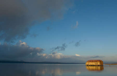 Photo of an old cannery building in Astoria, Oregon at sunset photo