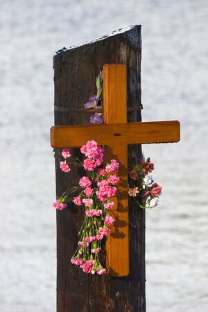 Photo of a cross left in memorial of a drowned boy at Knappa Dock, near Astoria, Oregon, USA