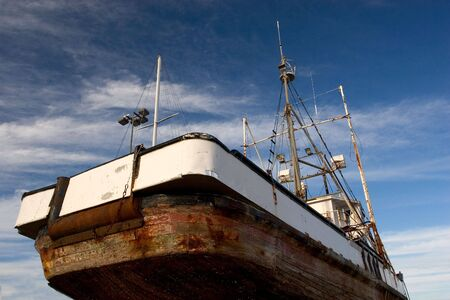 Photo of a fishing boat in dry dock, Astoria, Oregon photo