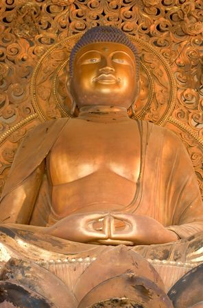 Photo of a Golden Buddha,  Byodo-In Temple on Oahu, Hawaii photo