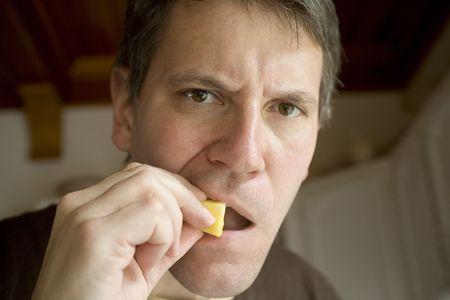 Photo of Bob eating a pineapple