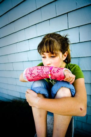 Photo of Maggie in a pink cast. Stock Photo