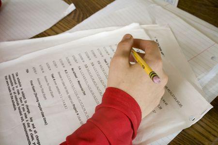drudgery: Photo of a boy doing math homework