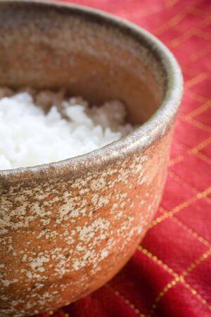 Photo of a ceramic bowl with white rice.
