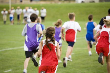 Photo of cross country runners racing. photo