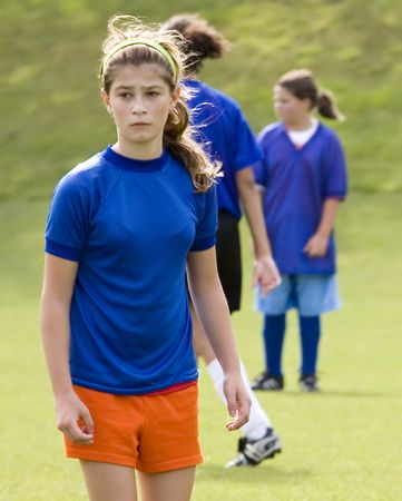 Photo of a female soccer player in a blue uniform.